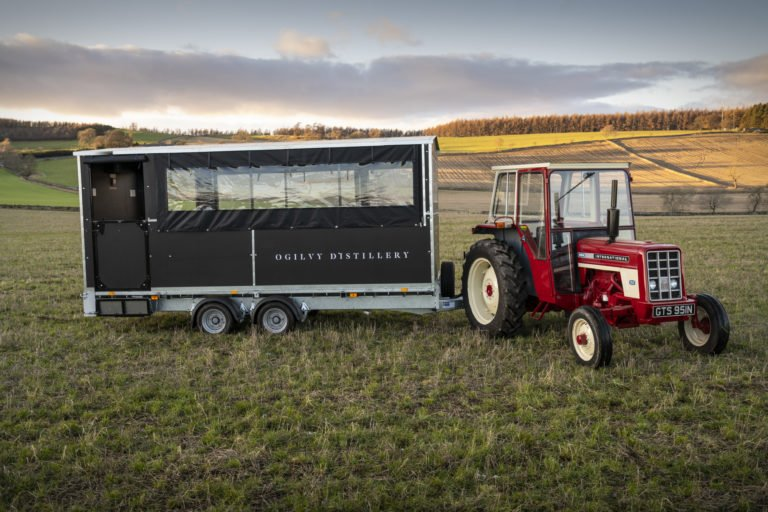 ogilvy tractor and trailer in field